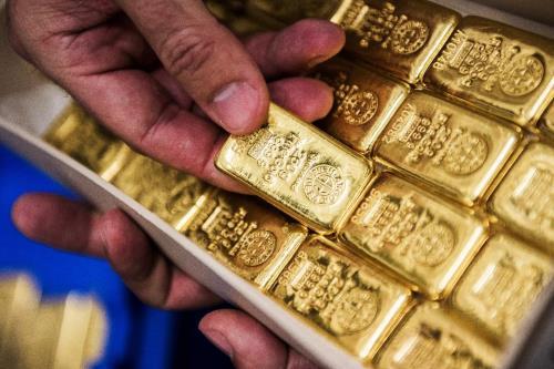 Đồng USD hồi phục, giá vàng châu Á đi xuống